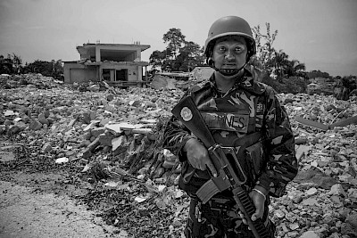 UN soldier in front of American embassy after earthquake