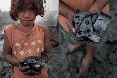 Girl collects metal scraps